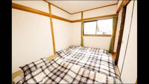 Apartment in Sakuragawa, Apartmanok  Oszaka - big - 11