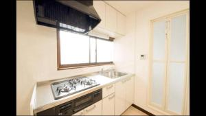 Apartment in Sakuragawa, Apartmanok  Oszaka - big - 10