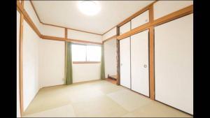 Apartment in Sakuragawa, Apartmanok  Oszaka - big - 7