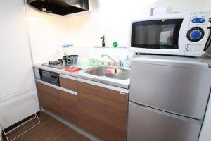 Apartment in Hoshin 104, Апартаменты  Осака - big - 4