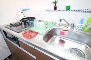 Apartment in Hoshin 104, Апартаменты  Осака - big - 17
