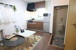 Apartment in Hoshin 104, Апартаменты  Осака - big - 21