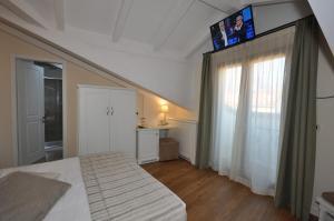 Hotel Garni Corona, Отели  Менаджо - big - 48