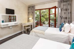 Miles B&B Guest House, Bed & Breakfasts  Oudtshoorn - big - 30