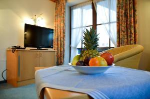 Hotel Restaurant Ferienwohnungen ALPENHOF, Apartmánové hotely  Übersee - big - 19
