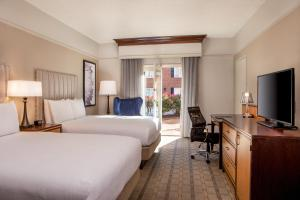 Queen Room with Two Queen Beds and Courtyard Access