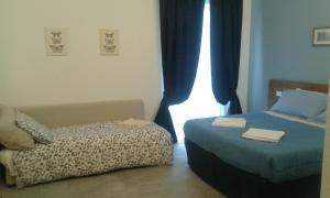 La Veranda Sul Giardino, Отели типа «постель и завтрак»  Коринальдо - big - 18