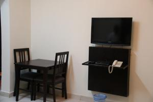 Dorar Darea Hotel Apartments - Al Mughrizat, Residence  Riyad - big - 13
