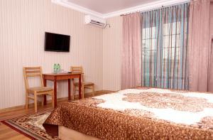 Guest house Aquarel, Penzióny  Goryachiy Klyuch - big - 13