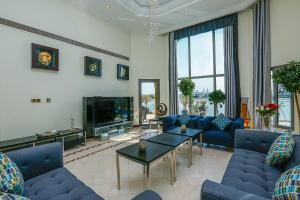 E&T Holiday Homes - Frond C Villa, Дубай