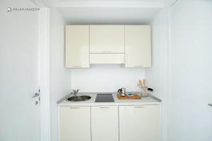Amicis 80 Style Studio - Milan Maison - AbcAlberghi.com