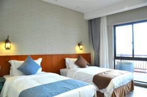 Mantaihu Four Season Guesthouse Suzhou Waipoqiao, Penzióny  Suzhou - big - 10
