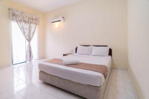 HIG Homestay Apartment, Privatzimmer  Kuah - big - 13
