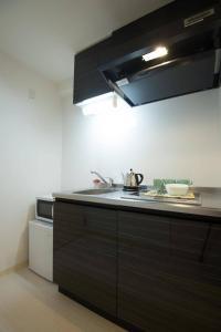 Apartment in Kuwazu 431, Apartmanok  Oszaka - big - 6