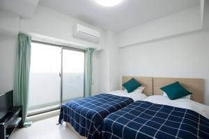 Apartment in Kuwazu 429, Ferienwohnungen  Osaka - big - 3