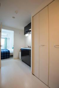 Apartment in Kuwazu 424, Appartamenti  Osaka - big - 2