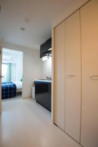 Apartment in Kuwazu 429, Ferienwohnungen  Osaka - big - 5
