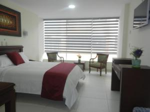 Hotel Cosmopolita Ambato, Szállodák  Ambato - big - 18