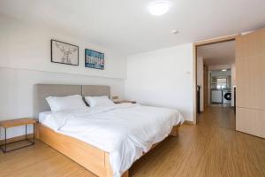 Queen Apartment Puwu Three Bedrooms Loft, Апартаменты  Сямынь - big - 14