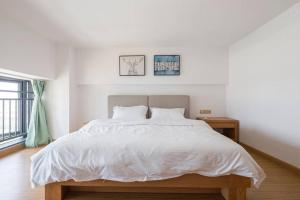 Queen Apartment Puwu Three Bedrooms Loft, Апартаменты  Сямынь - big - 12