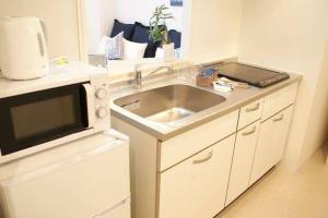 Apartment in Yamashina 402, Apartmanok  Kiotó - big - 17