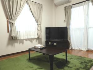 Forest Hills of Yanbaru, Апартаменты  Мотобу - big - 8