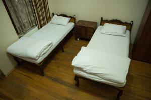 ドミトリールーム 男女共用 ベッド計4台のベッド1台