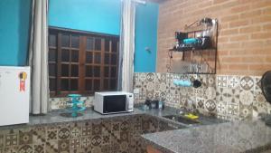 Toca Hospedaria - Centro, Apartmanok  São Bento do Sapucaí - big - 13