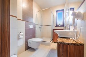 Apartamenty Sun & Snow Rezydencja Park, Appartamenti  Mielno - big - 11