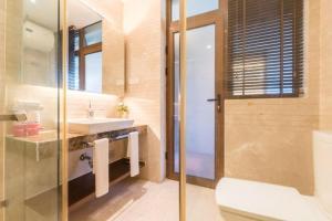 Xinyue Lijing Apartment, Appartamenti  Sanya - big - 2