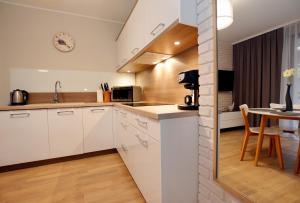 Apartamenty Sun & Snow Rezydencja Park, Appartamenti  Mielno - big - 50