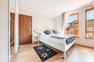 Apartamenty Sun & Snow Rezydencja Park, Appartamenti  Mielno - big - 35