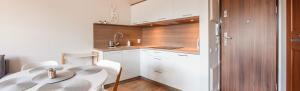 Apartamenty Sun & Snow Rezydencja Park, Appartamenti  Mielno - big - 75
