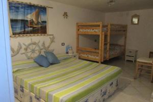 Holiday home Via delle Ginestre, Holiday homes  Torre Dei Corsari - big - 7