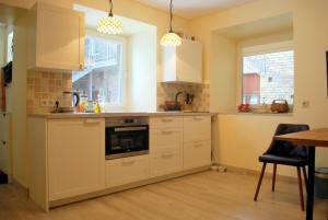 Near fireplace, Apartments  Vilnius - big - 6