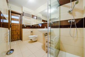 Apartamenty Sun & Snow Olympic, Апартаменты  Колобжег - big - 98