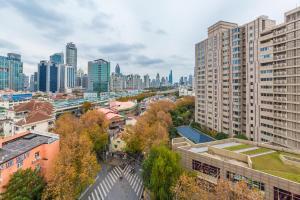 Henry's Apartment - South Maoming Road, Апартаменты  Шанхай - big - 2