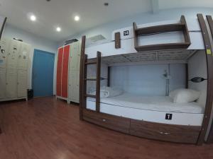 Cama en habitación compartida de 14 camas