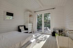 Magnifique villa avec piscine au Cap Feret, Dovolenkové domy  Cap-Ferret - big - 26
