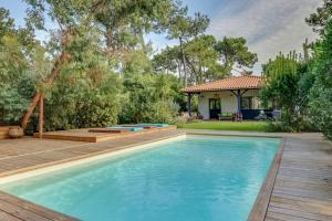 Magnifique villa avec piscine au Cap Feret, Dovolenkové domy  Cap-Ferret - big - 29