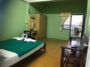 Dvoulůžkový pokoj typu Economy s manželskou postelí