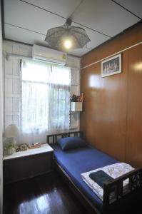 Jednolůžkový pokoj se společnou koupelnou