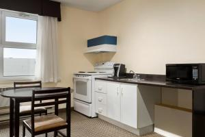 King Room with Two Double Beds and Kitchenette - Non-Smoking