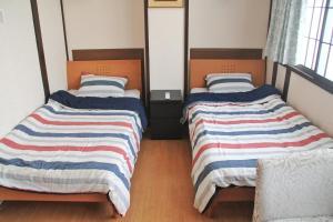 Naniwa Guest House, Apartmanok  Oszaka - big - 23
