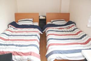 Naniwa Guest House, Apartmanok  Oszaka - big - 20