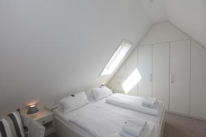Landhaus Wiesenweg, Case vacanze  Wenningstedt - big - 15