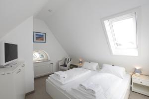 Landhaus Wiesenweg, Case vacanze  Wenningstedt - big - 16