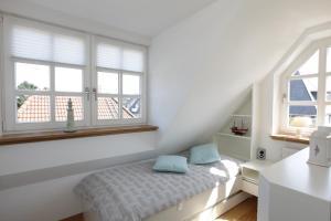 Landhaus Wiesenweg, Case vacanze  Wenningstedt - big - 23