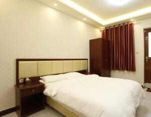 Aijia Apartment, Affittacamere  Kaifeng - big - 13