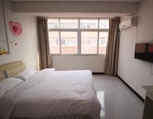 Aijia Apartment, Affittacamere  Kaifeng - big - 17